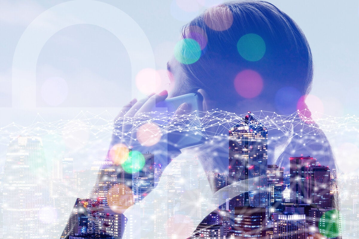 woman on smartphone city network security leader iot