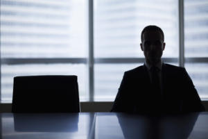 boardroom job opening executive in silhouette empty chair new job