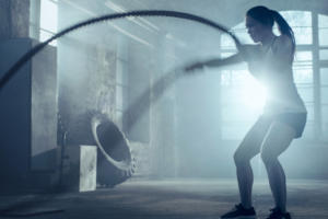 cross training crossfit ropes woman exercising fitness gym