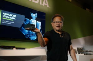 Nvidia CEO Jensen Huang holds a Jetson Xavier