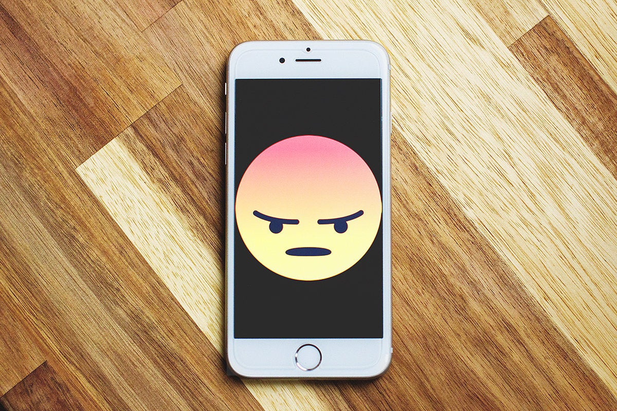angry face emoji on mobile phone
