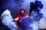 anonymous / Guy Fawkes Mask / hoodie / hacker / smoke grenades / security / protest / disruption