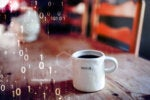Digital Transformation / In a binary environment, a coffee mug is labeled 'begin.'