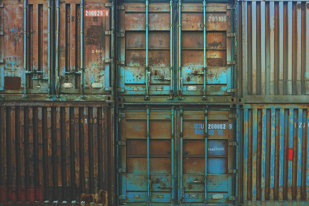 containers rust storage compartment shipping crates blue by boba jovanovic via unsplash