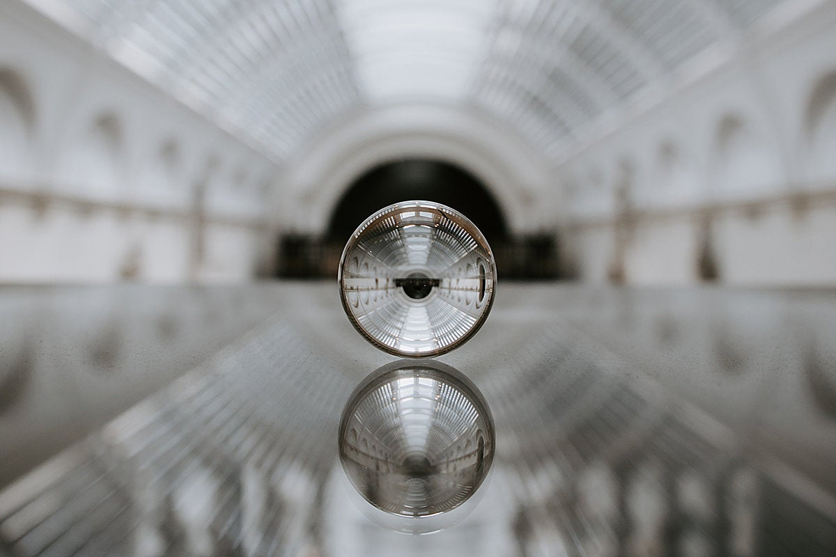 Architectural dome reflected in a crystal ball. / future / predictions / forecast / fortune telling