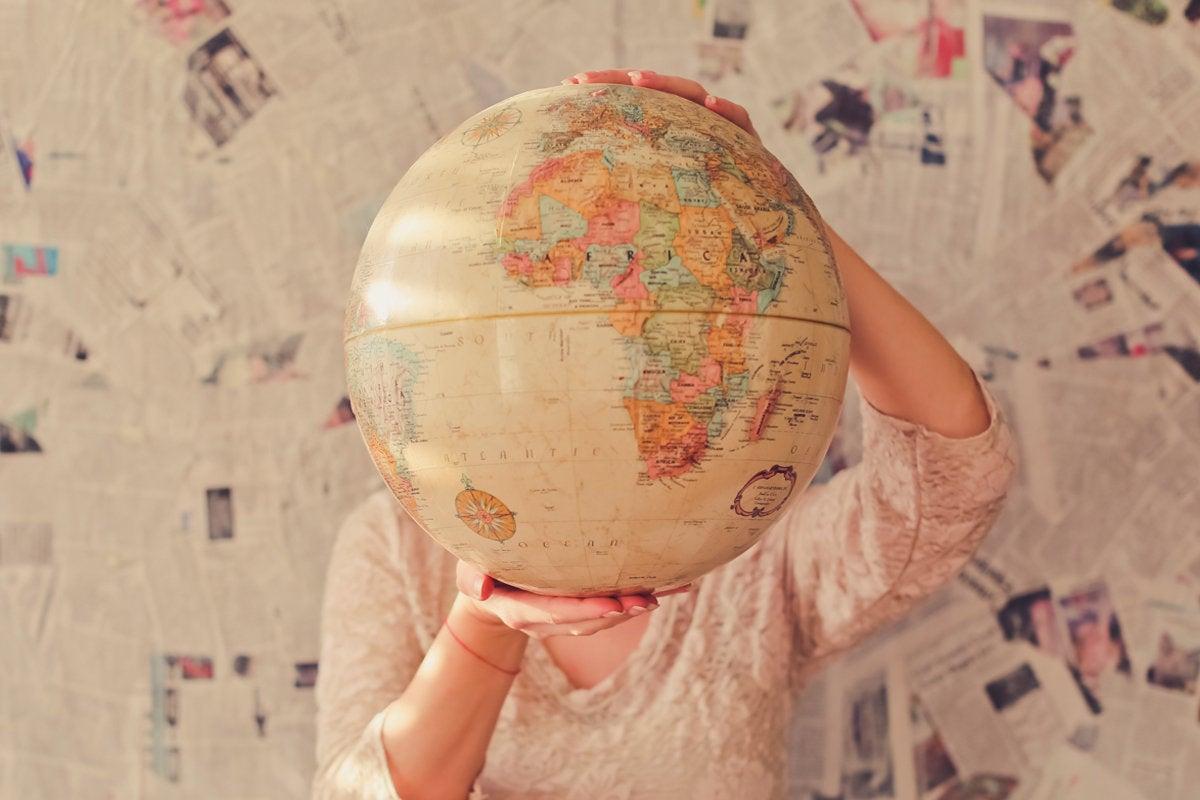 globe map outsourcing international travel slava bowman unsplash