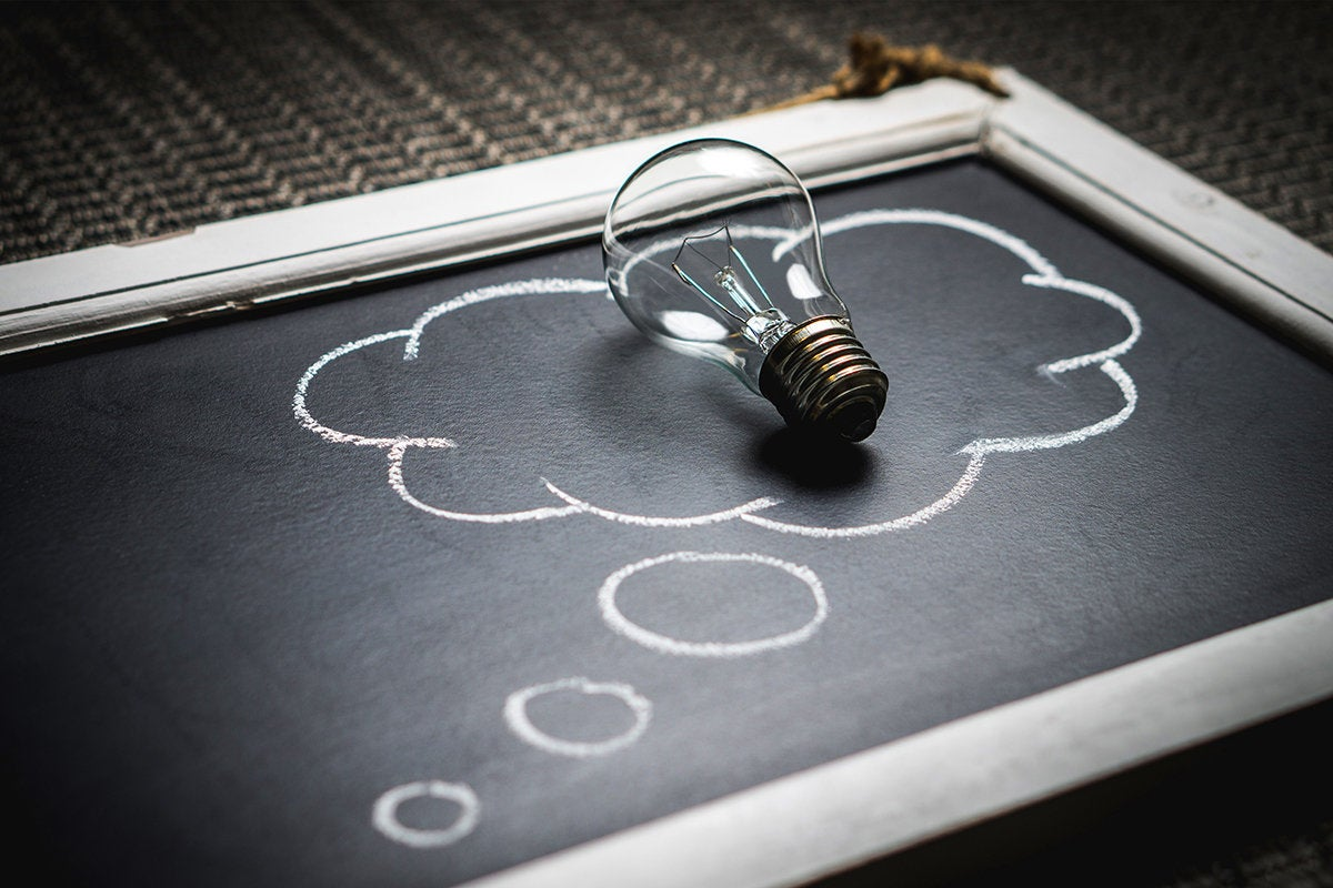 lightbulb on chalkboard / idea / innovation / imagination / invention / education / brainstorm