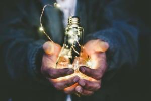 lightbulb / light string hands / ideas / brainstorming / invention / innovation