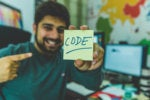 man holding code sign programmer developer devops data scientist tech roles hitesh choudhary via un