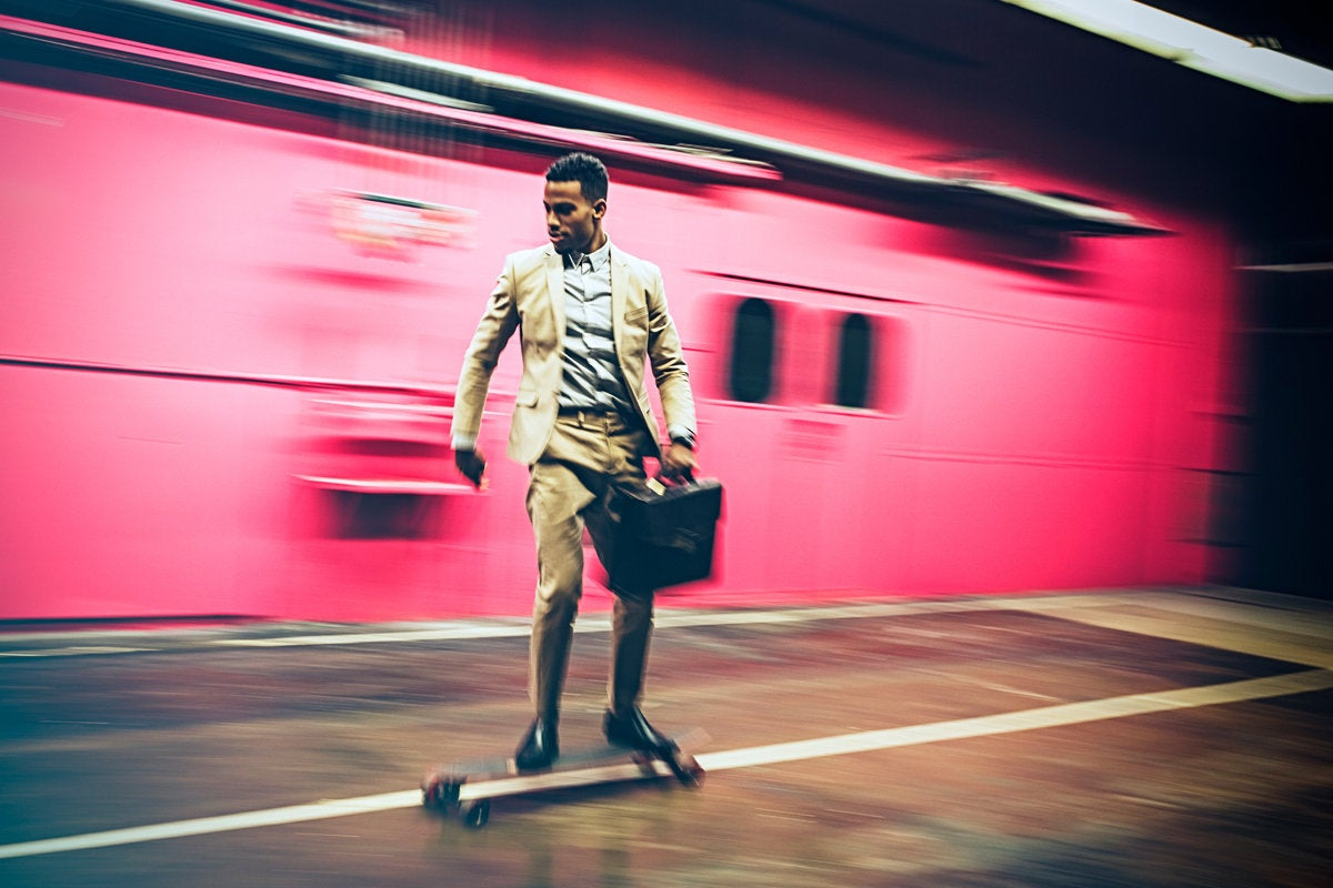 man skating on longboard speed responsive agile executive with briefcasse