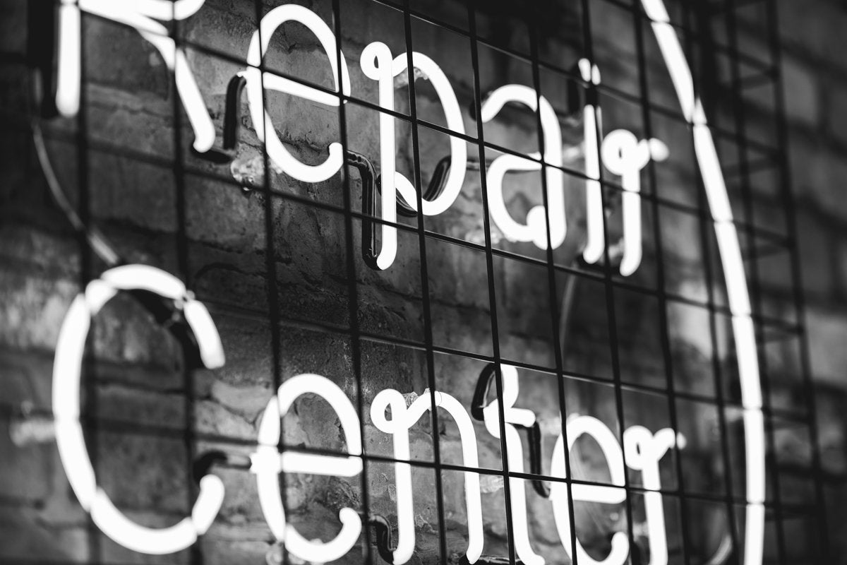 neon repair sign fix patch by dana vollenweider unsplash