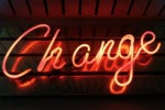 neon sign change management agent career promotion shift start begin by ross findon via unsplash