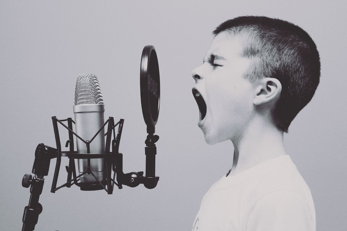 sing yell announce microphone boy shout communicate perform by jason rosewell unsplash