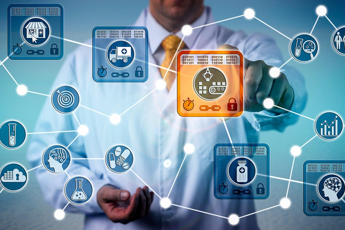 blockchain in healthcare / doctor accesses one block in a chain of digital medical records
