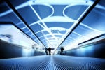 business travel / airport terminal walkway / traveller