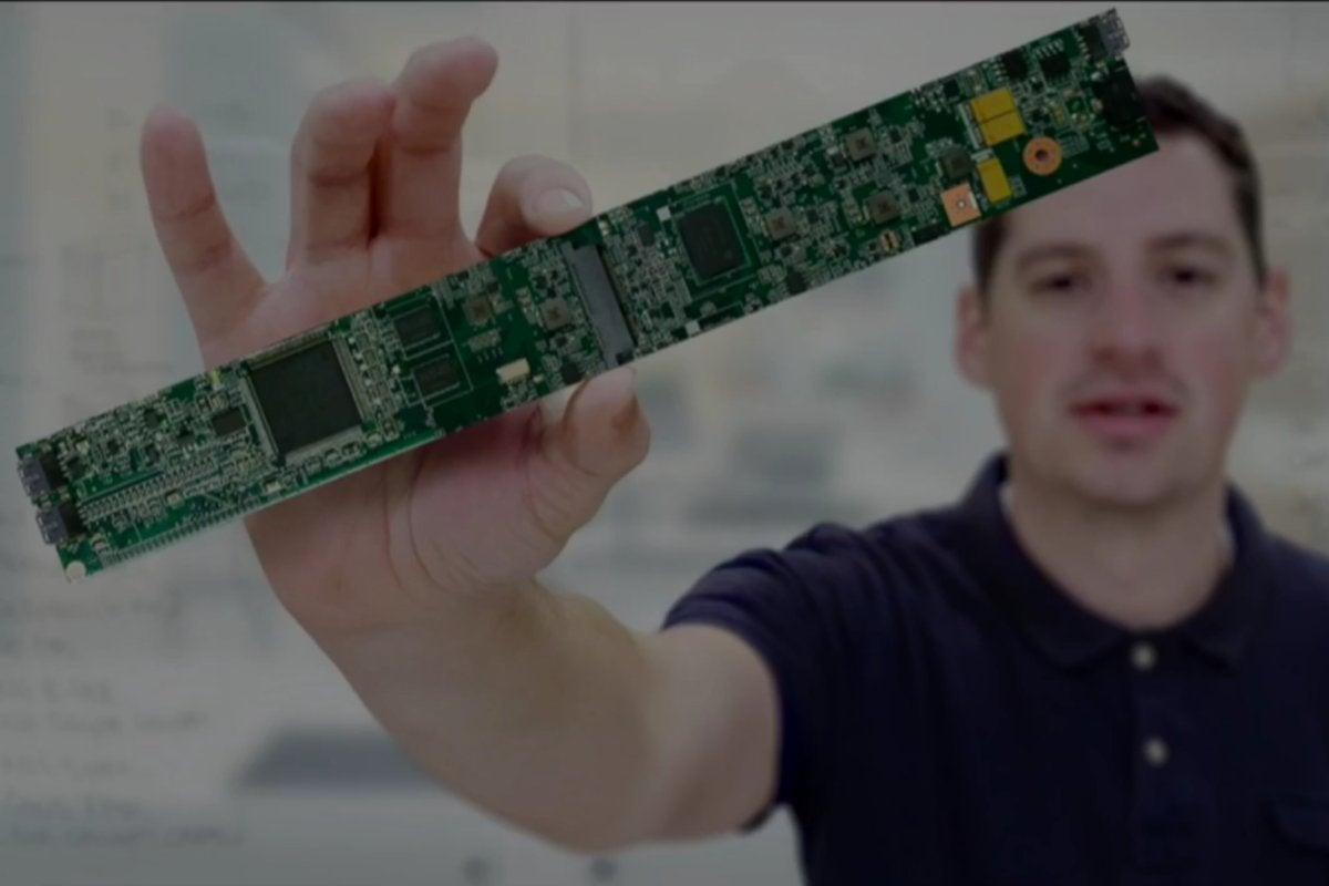 hp spectre folio motherboard held by man