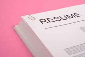 resume pink background cv job interview stack of paper