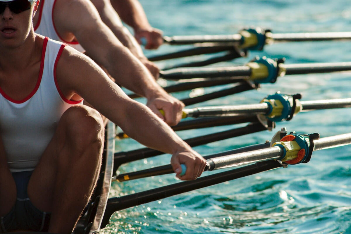 rowing crew team teammates water compete synchronized rythm coordination