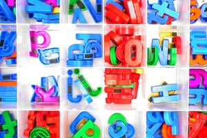 Plastic, magnetic letters in compartmented boxes.