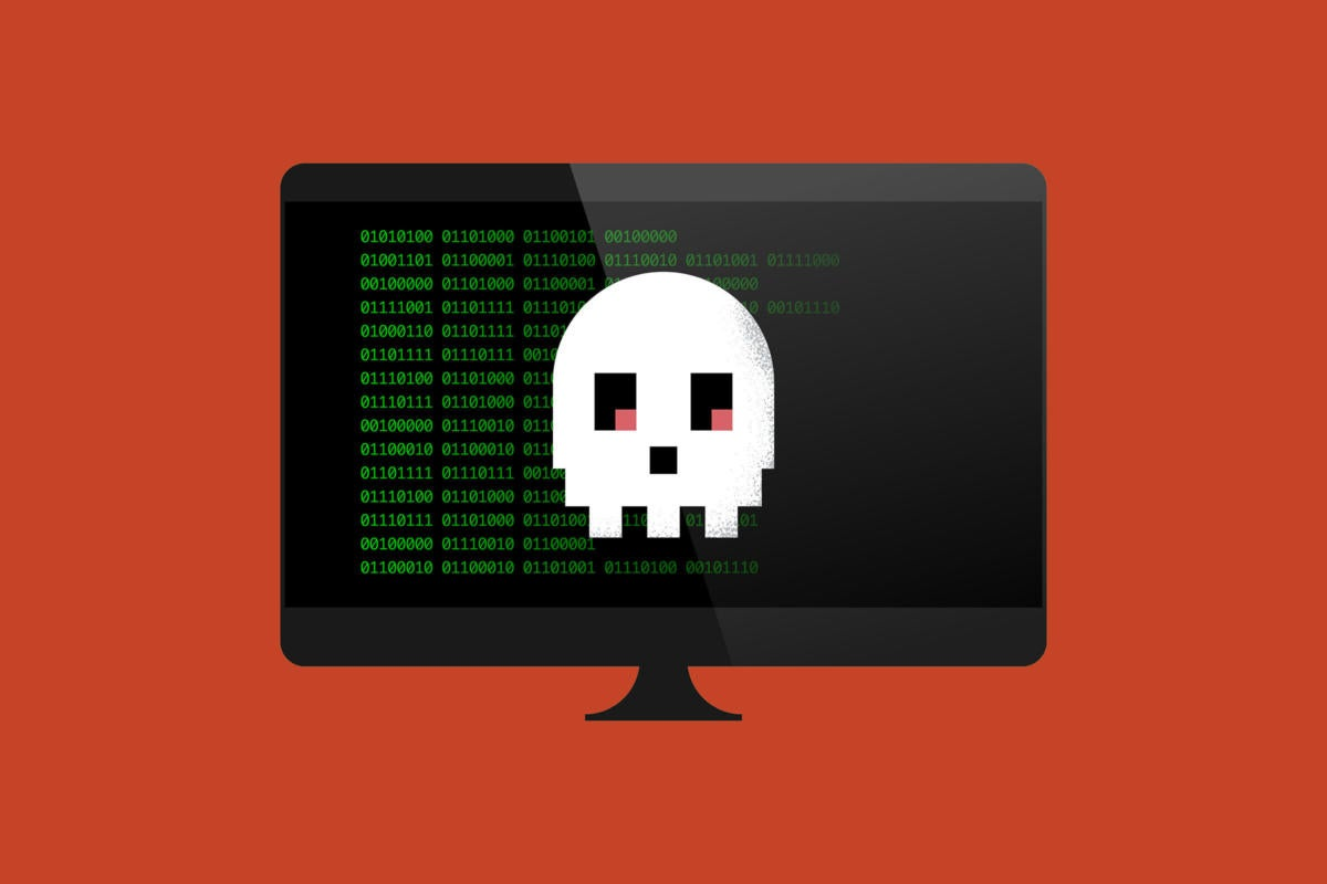 A computer monitor displays code and a pixelated skull.