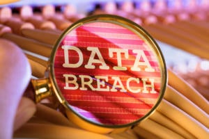 Networking cables viewed through a magnifying lens reveal a data breach.