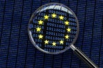 Binary flag of the European Union viewed through a magnifying lens and showing a ripple effect.