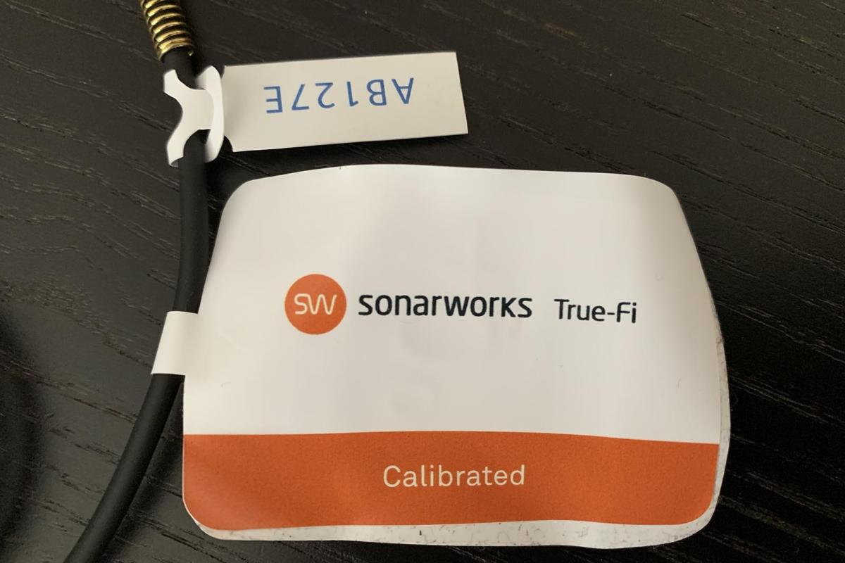 Each calibrated set of headphones is tagged and numbered.