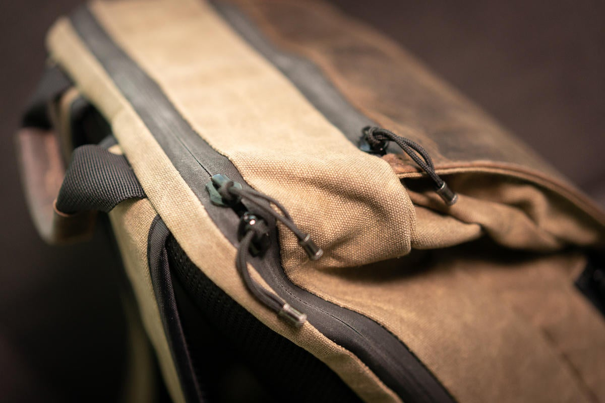 sutter slim backpack zippers