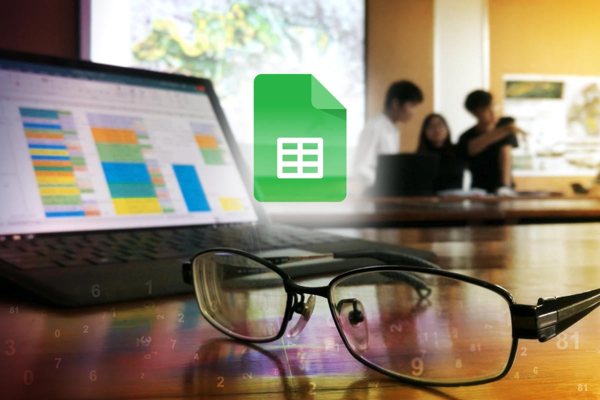 Google Sheets logo / Spreadsheet displayed on a laptop screen while a team works in the background.