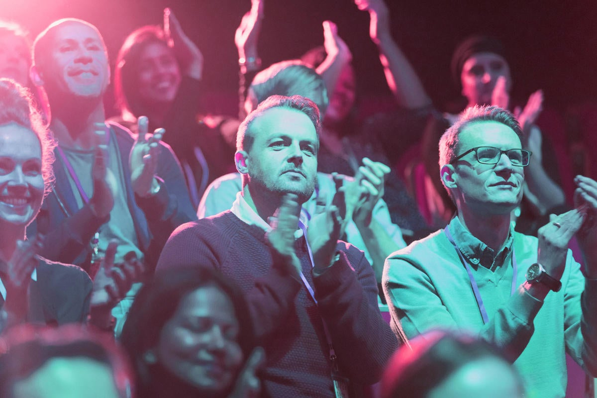 best conferences to attend conference convention audience applause clapping by django getty