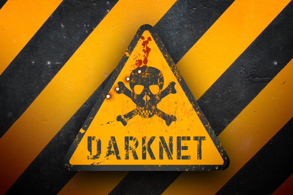Dark net warning sign against black and yellow warning stripes in the background.
