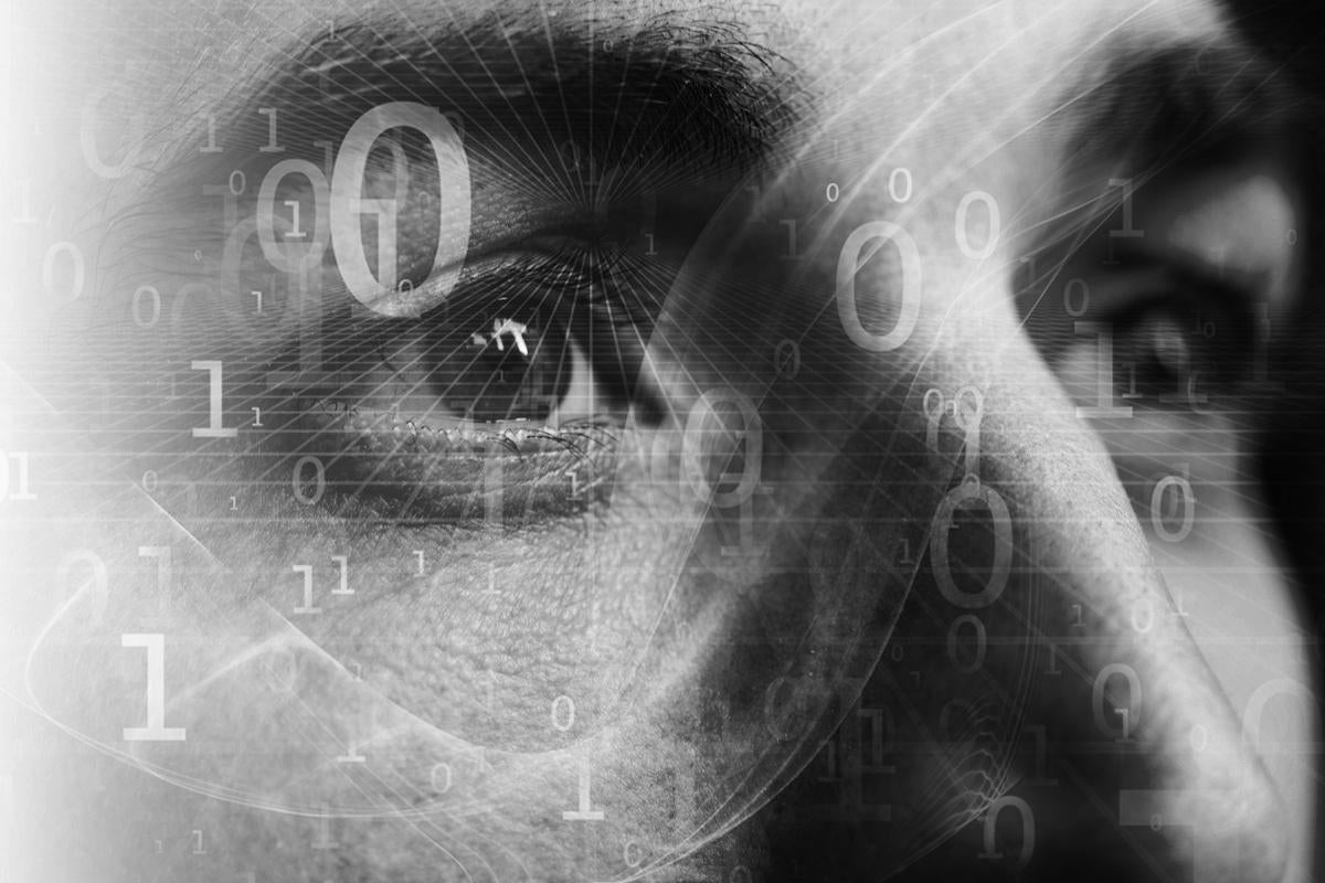 data scientist face in profile with binary numbers analystics