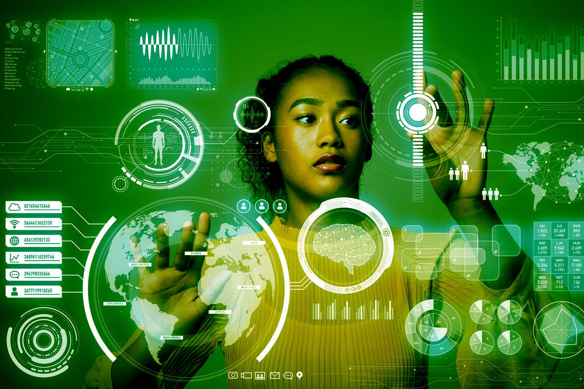 data scientist woman at virtual monitor user interface tools for data science by metamorworks getty