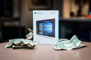 Windows 10 boxed on table with crumpled money