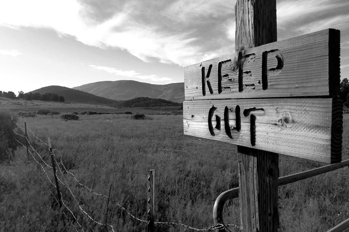 keep out sign do not tresspass privacy authentication access barbed wire by tim husser getty