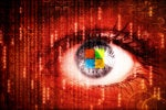 Abstract binary data overlays an eye containing a reflection of the Microsoft logo.