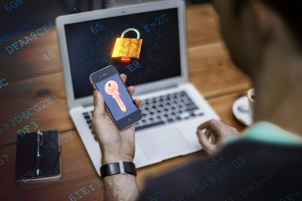 Multifactor authentication  >  A mobile phone displays a digital key to a lock on a user's laptop.