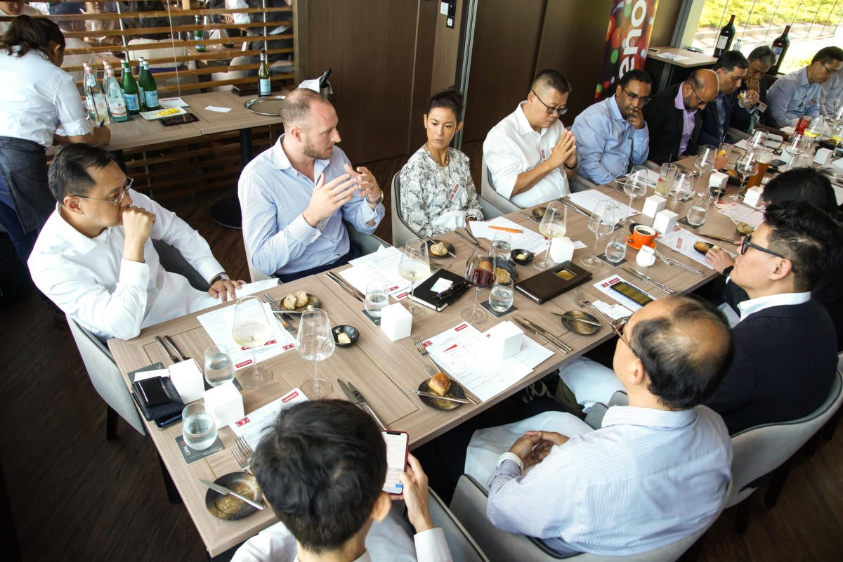 Guests debate during CIO ASEAN's roundtable: 'Digital business transformation in action: Keys for su
