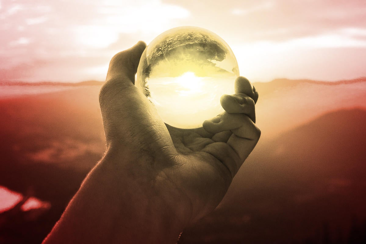 prediction predict the future crystal ball hand holding crystal ball by arthur ogleznev via unsplash