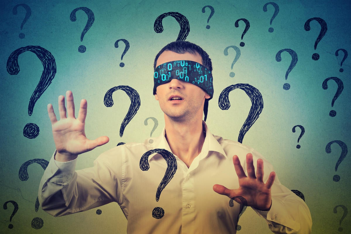 Cybersecurity awareness  >  A man with a binary blindfold finds his way through question marks.