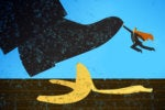 A shoe about to step on a banana peel, stopped by a small superhero.
