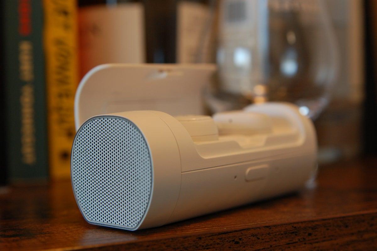Phiaton Bolt BT 700 earbuds in open case on bookshelf