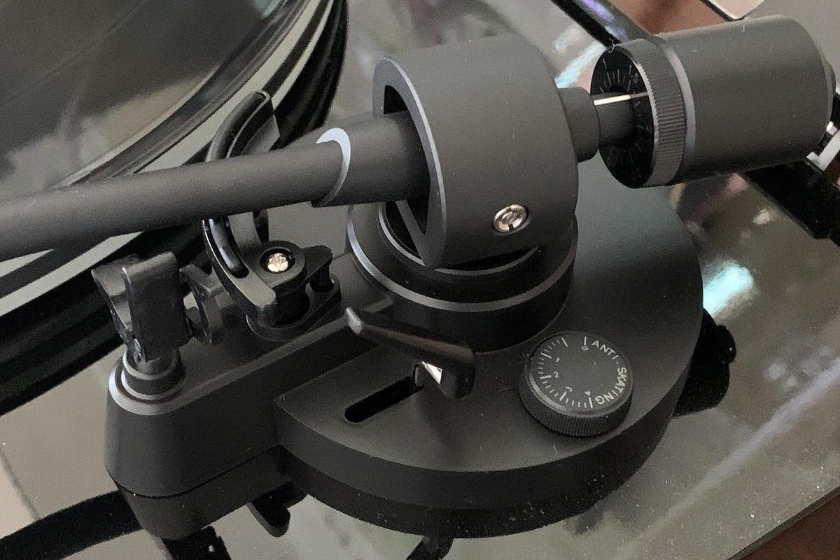 Detail view of the tonearm and anti-skate dial.