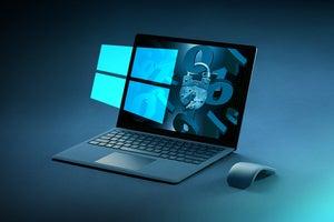 Microsoft Windows security  >  Windows laptop + logo with binary lock and key