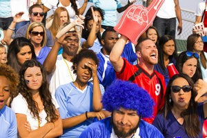 sports one fan cheers the opposing team by fstop123 gettyimages 471924821
