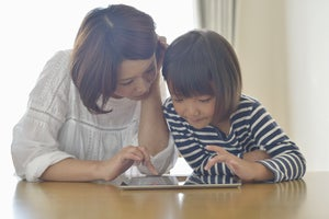home mother daughter tablet gettyimages 186422816