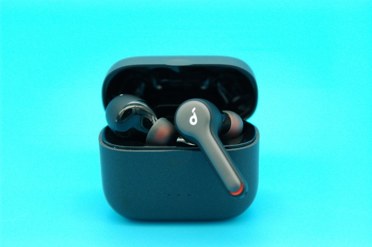 Liberty Air 2 true wireless earbuds one hanging off case