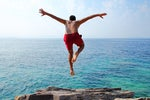 cliff diving taking the plunge dive into a project ocean swimming by aydinmutlu getty 2400x1600