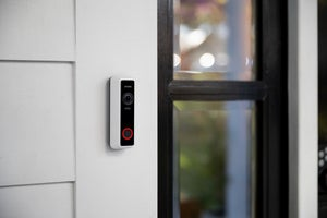 close up of an installed illuminated vivint doorbell camera pro