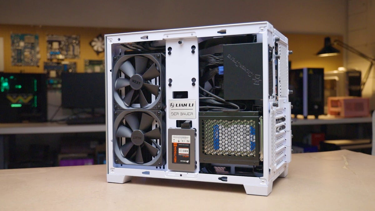 o11d mini with right side panel off and populated with fans and drives